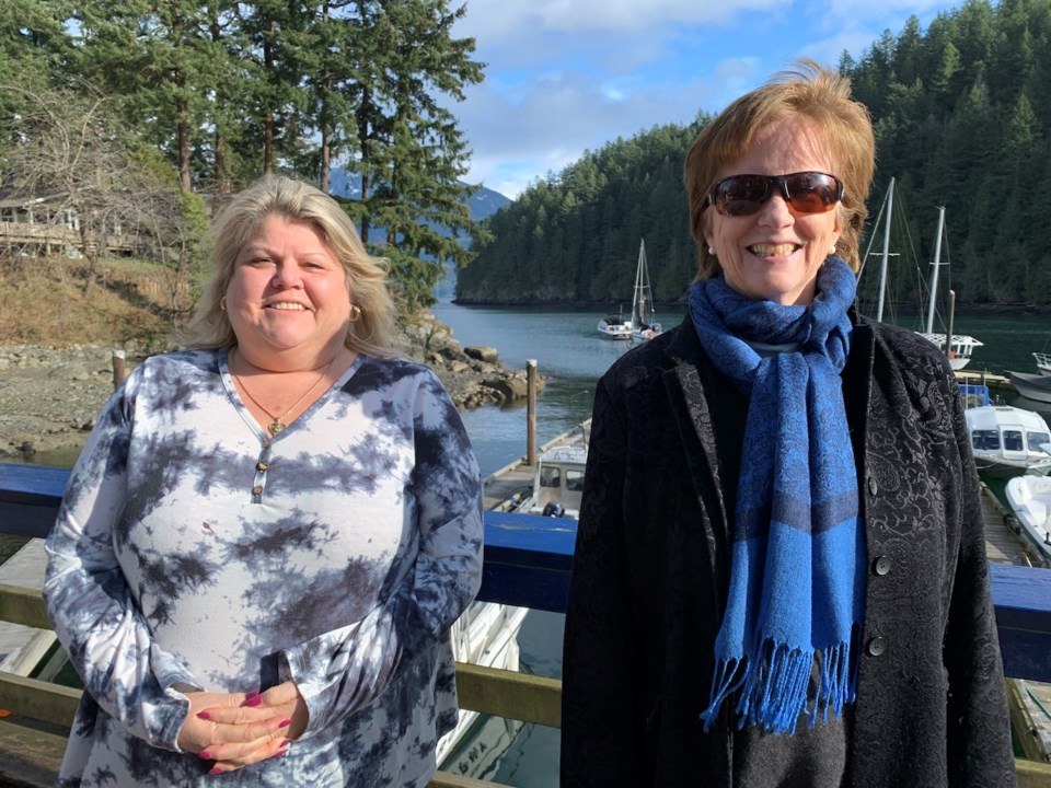 kim-sinclair-standing-with-colleen-o'neil-on-the-bowen-government-dock